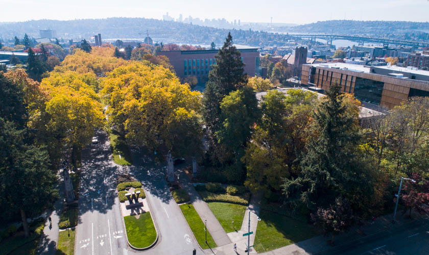 Aerial view of the north entrance to UW with Seattle in the distance