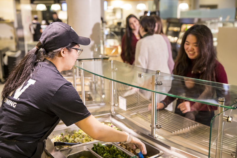 Student employee serving food at Tero in Local Point