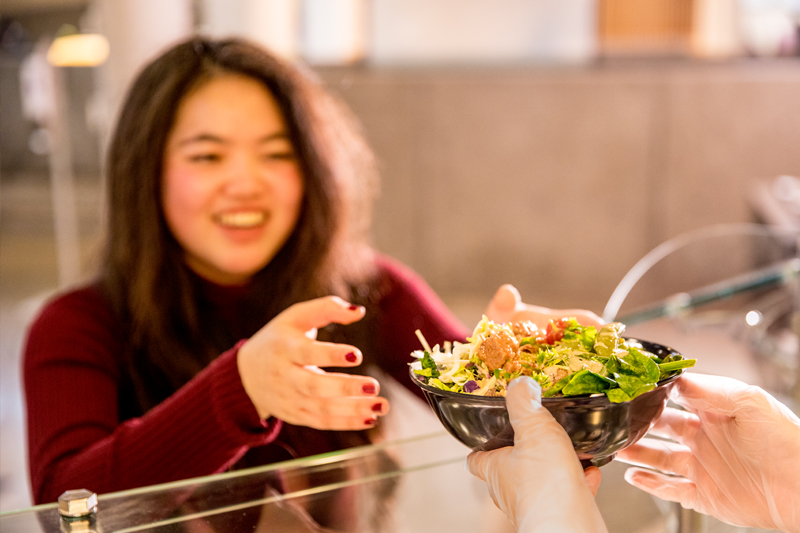 Resident student dining at Local Point
